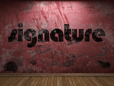 signature: signature word on red wall Stock Photo