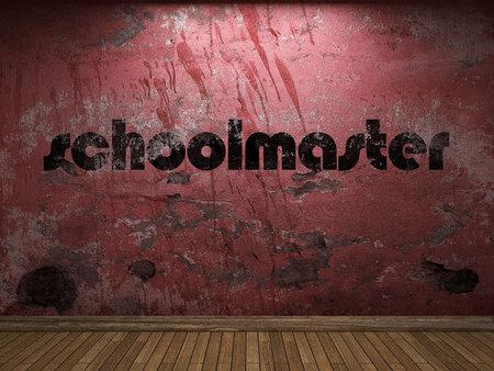 schoolmaster word on red wall