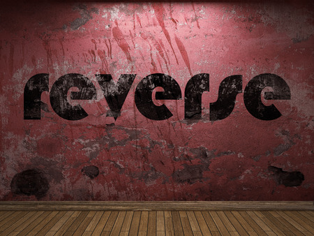 reverse: reverse word on red wall Stock Photo