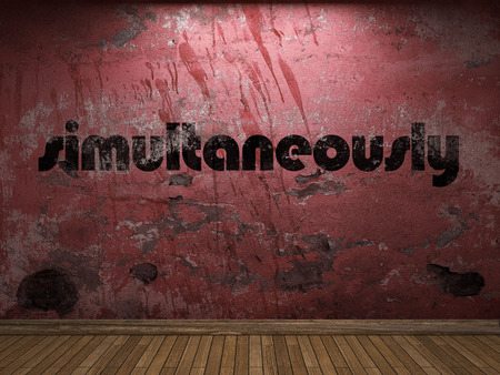 simultaneously: simultaneously word on red wall