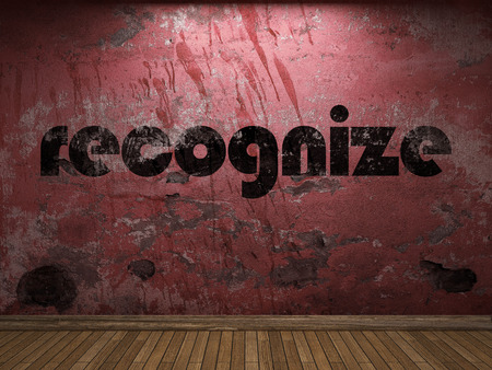 recognize: recognize word on red wall Stock Photo