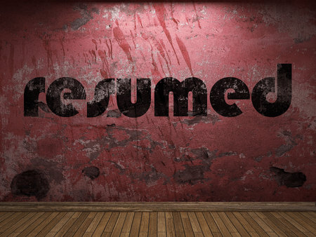 resumed: resumed word on red wall Stock Photo