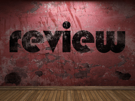 review: review word on red wall Stock Photo