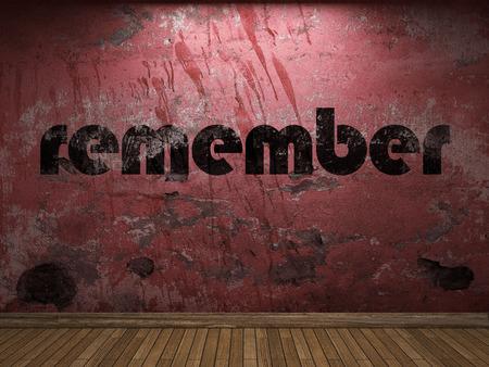 recordar: recordar la palabra en la pared roja Foto de archivo