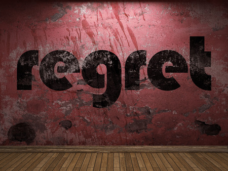 regret: regret word on red wall Stock Photo