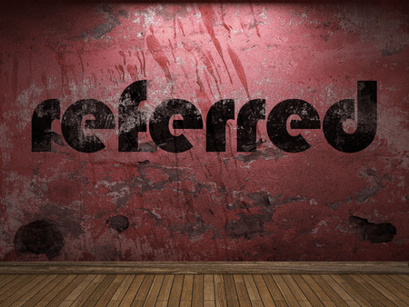 referred: referred word on red wall Stock Photo
