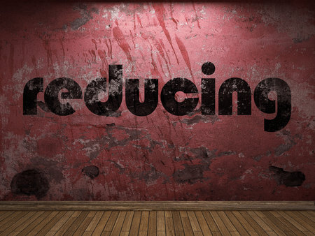 reducing: reducing word on red wall