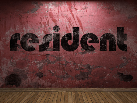 resident: resident word on red wall Stock Photo