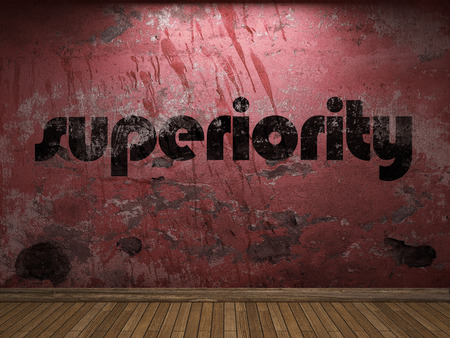 superiority: superiority word on red wall