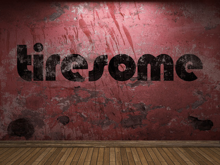 tiresome: tiresome word on red wall Stock Photo