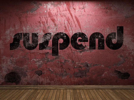 suspend: suspend word on red wall Stock Photo