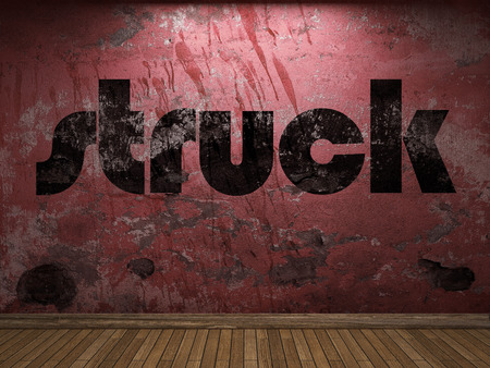 struck: struck word on red wall Stock Photo