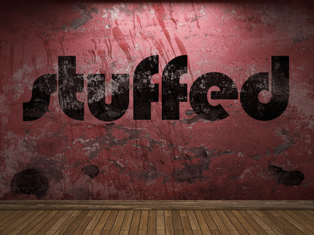 plaster board: stuffed word on red wall Stock Photo