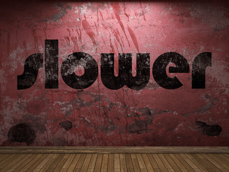 slower: slower word on red wall Stock Photo