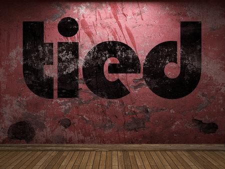 gefesselt: tied word on red wall