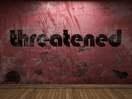 threatened: threatened word on red wall