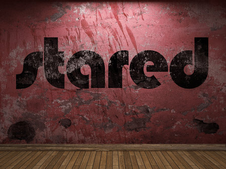 stared: stared word on red wall Stock Photo