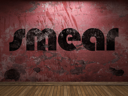 smear: smear word on red wall Stock Photo