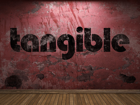 tangible word on red wall