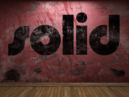 solid: solid word on red wall Stock Photo