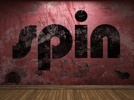 spin: spin word on red wall Stock Photo