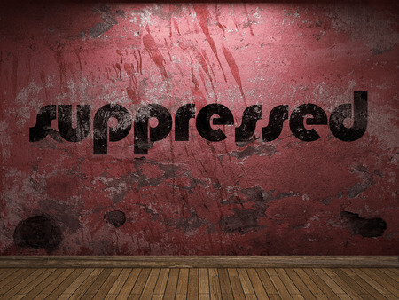 suppressed: suppressed word on red wall Stock Photo
