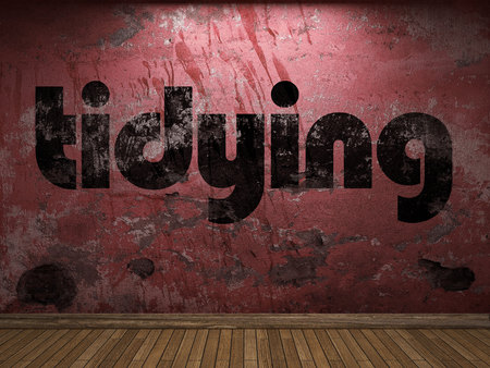 tidying: tidying word on red wall