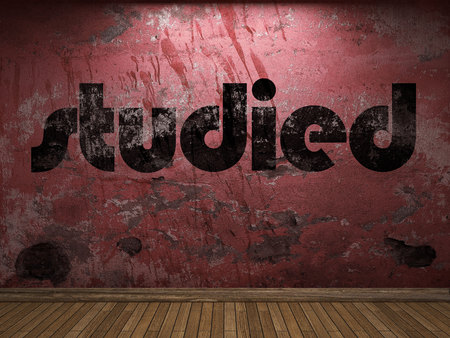 studied: studied word on red wall
