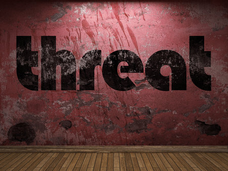 parola di minaccia sulla parete rossa Archivio Fotografico