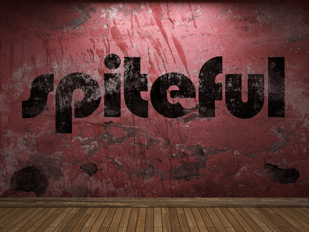 spiteful: spiteful word on red wall Stock Photo