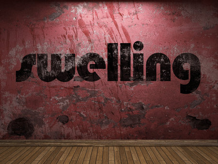 swelling: swelling word on red wall Stock Photo