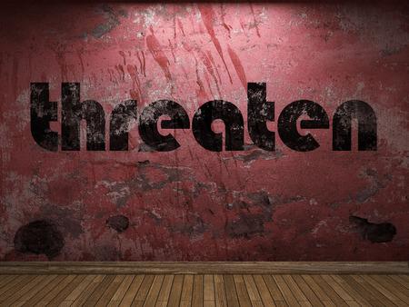 threaten: threaten word on red wall Stock Photo