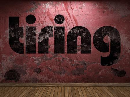tiring: tiring word on red wall