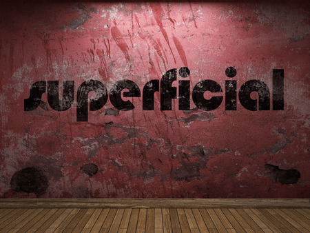 superficial: superficial word on red wall