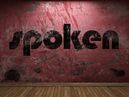 spoken: spoken word on red wall Stock Photo