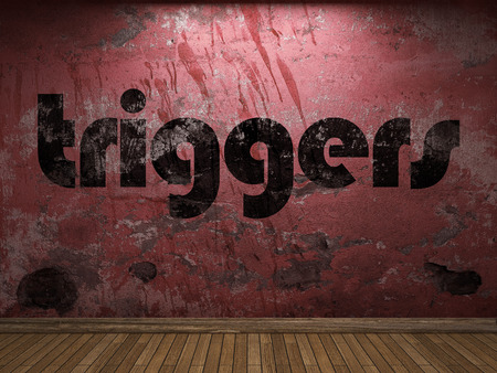 triggers: triggers word on red wall Stock Photo