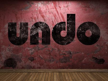 undo: undo word on red wall Stock Photo