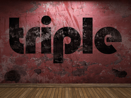 triple: triple word on red wall Stock Photo