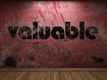 valuable: valuable word on red wall Stock Photo