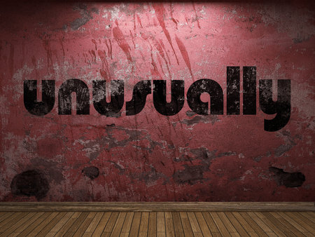 unusually: unusually word on red wall
