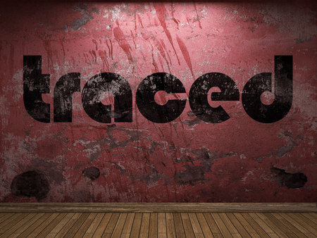 traced: traced word on red wall Stock Photo