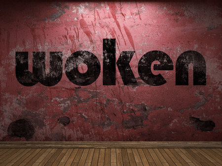 woken: woken word on red wall Stock Photo