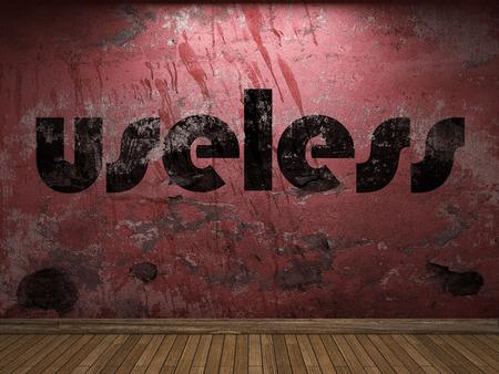 useless: useless word on red wall Stock Photo