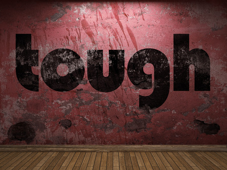 tough: tough word on red wall Stock Photo