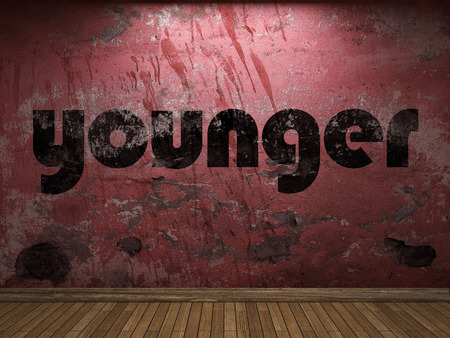 younger: younger word on red wall Stock Photo