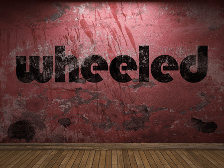 wheeled: wheeled word on red wall Stock Photo