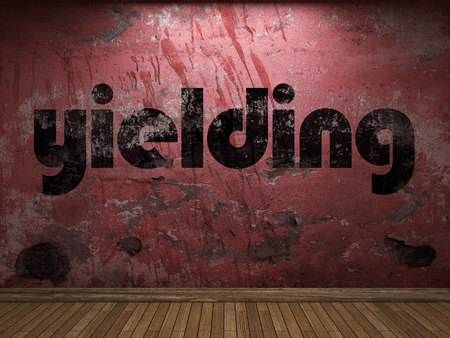 yielding: yielding word on red wall