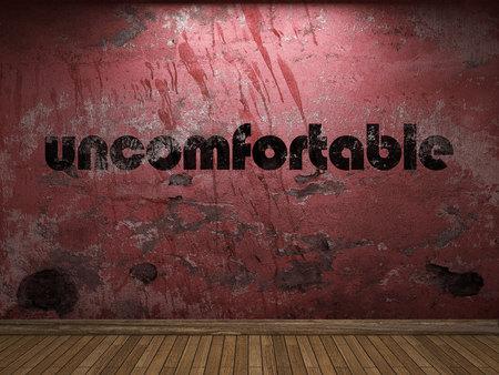 uncomfortable: uncomfortable word on red wall Stock Photo