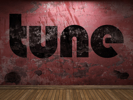 tune: tune word on red wall