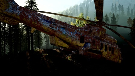 old rusted military helicopter in the mountain forest at sunrise Archivio Fotografico